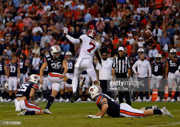 Anders Carlson of the Auburn Tigers kicks a field goal as the clock expires in the first half against the Alabama Crimson Tide at Jordan Hare Stadium...