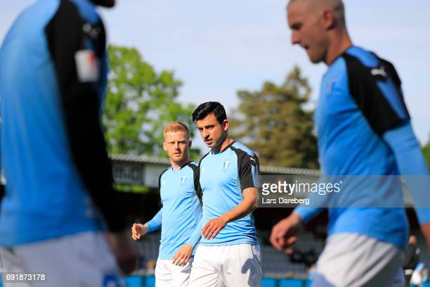 Anders Christiansen and Behrang Safari of Malmo FF during the Allsvenskan match between Jonkopings Sodra IF and Malmo FF at Stadsparksvallen on June...