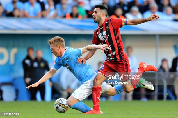 Anders Christiansen of Malmo FF and Brwa Nouri during the Allsvenskan match between Malmo FF and Ostersunds FK at Swedbank Stadion on May 14 2017 in...