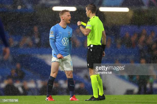 Anders Christiansen of Malmo FF reacts after being shown a yellow card by match referee Francois Letexier during the UEFA Champions League group H...