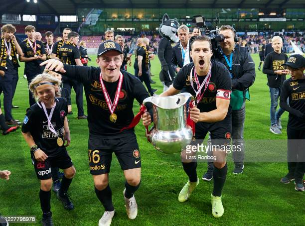 Anders Dreyer and Erik Sviatchenko of FC Midtjylland of FC Midtjylland celebrate with the trophy as danish champions after the Danish 3F Superliga...
