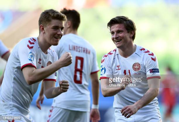 Anders Dreyer of Denmark celebrates with Andreas Poulsen after scoring their side's second goal during the 2021 UEFA European Under-21 Championship...