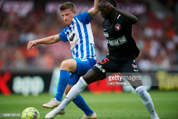 Anders Dreyer of Esbjerg fB and Awer Mabil of FC Midtjylland compete for the ball during the Danish Superliga match between FC Midtjylland and...