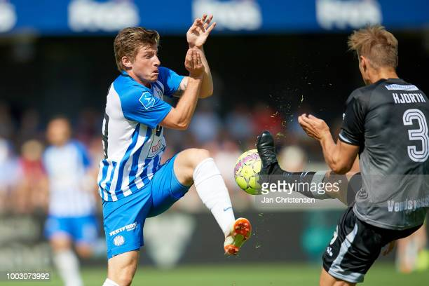 Anders Dreyer of Esbjerg fB and Jakob Hjorth of Vendsyssel FF compete for the ball during the Danish Superliga match between Esbjerg fB and...