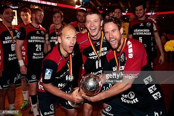 Anders Eggert Lasse Svan and Thomas Mogensen of Flensburg celebrate after winning the DHB Cup Final match between SG FlensburgHandewitt and SC...