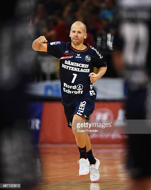 Anders Eggert of Flensburg celebrates scoring during the DKB Handball Bundeslga match between SG FlensburgHandewitt and THW Kiel at FlensArena on...