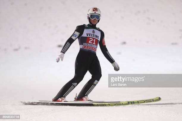 Anders Fannemel of Norway looks on as he competes in the FIS Nordic World Cup on day 2 of the Four Hills Tournament ski jumping event on December 30...