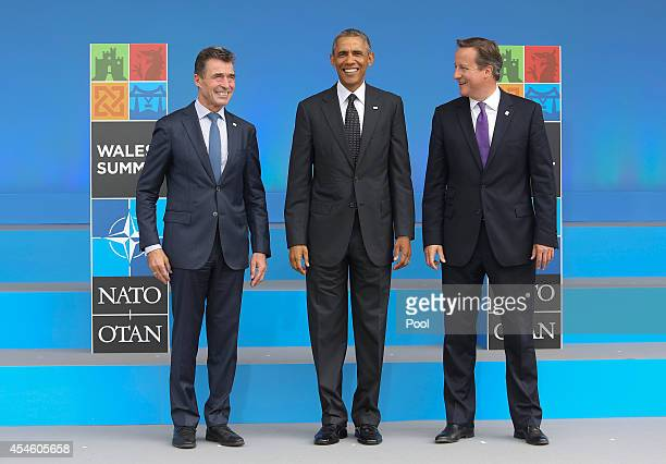 Anders Fogh Rasmussen Secretary General of the North Atlantic Treaty Organization stands with US President Barack Obama and British Prime Minister...