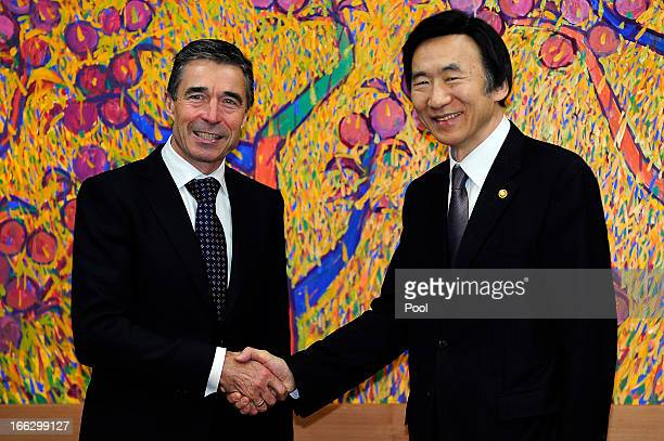 Anders Fogh Rasmussen the NATO Secretary General shakes hands with South Korean foreign minister Yun ByungSe during their meeting at the Ministry of...