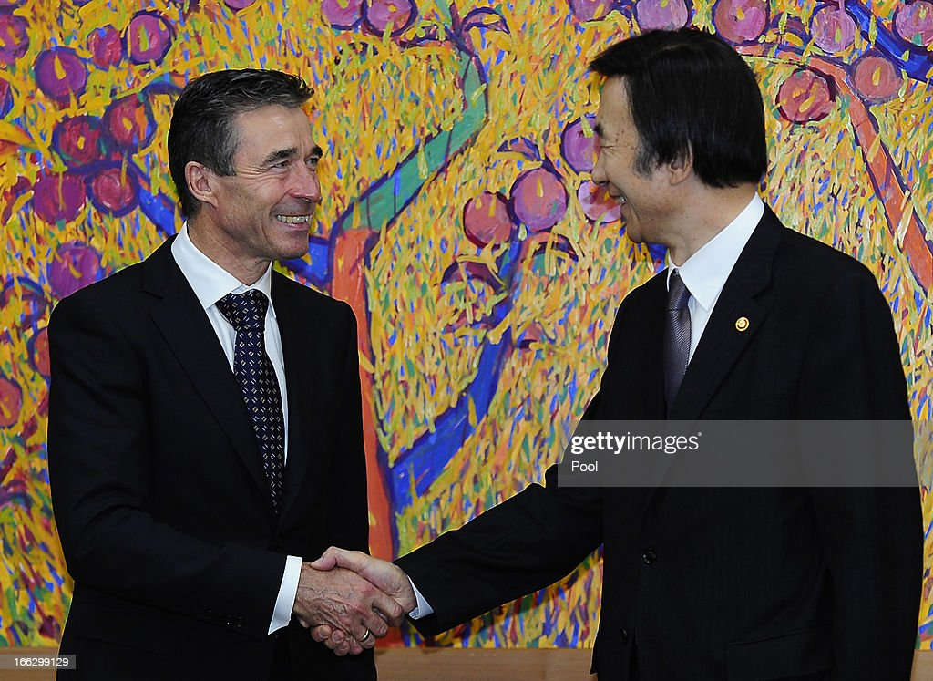Anders Fogh Rasmussen (L), the NATO Secretary General, shakes hands with South Korean foreign minister Yun Byung-Se (R) during their meeting at the Ministry of Foreign Affairs on April 11, 2013 in Seoul, South Korea. The NATO chief is on a 6 day tour to South Korea and Japan amid the tensions in the Korean Peninsula.