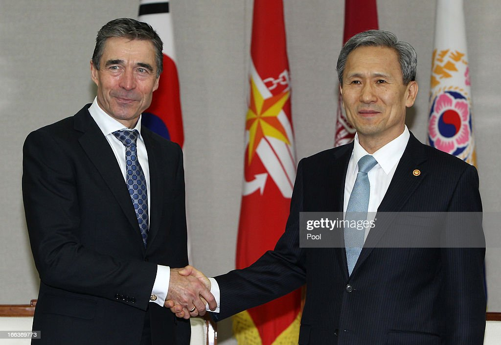 Anders Fogh Rasmussen (L), the NATO Secretary General, shakes hands with South Korean Defense Minister Kim Kwan-Jin (R) at the defense ministry on April 12, 2013 in Seoul, South Korea. NATO chief is on a six day tour to South Korea and Japan amidst the tension in the Korean Peninsula.