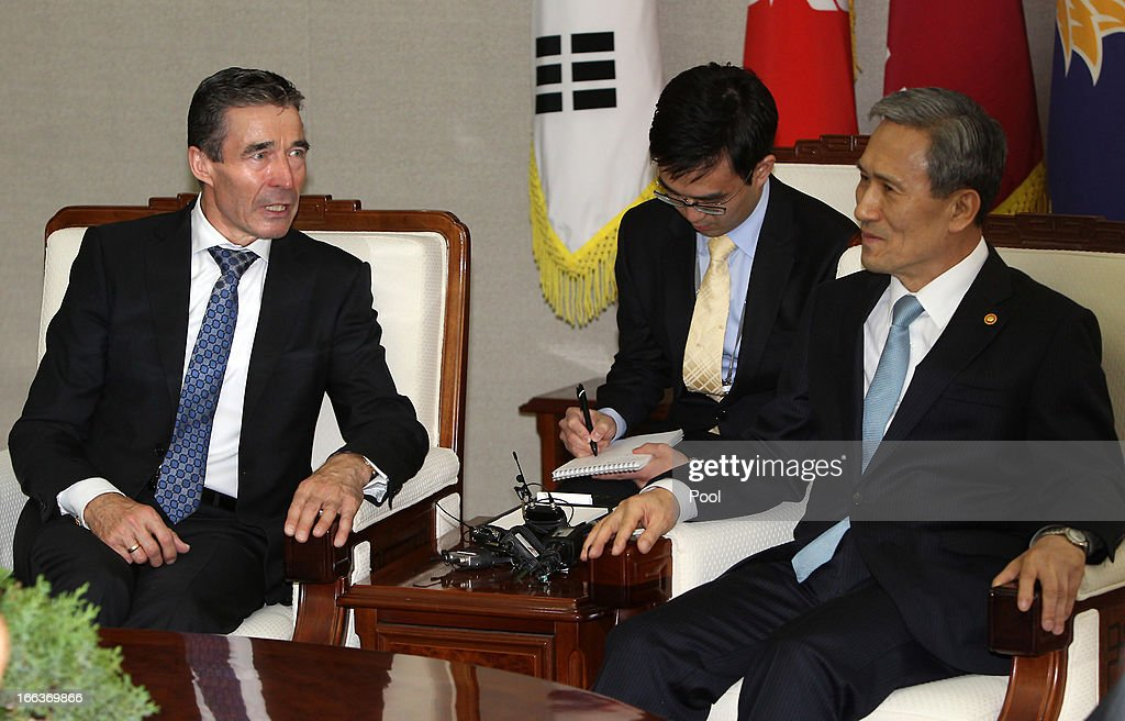 Anders Fogh Rasmussen (L), the NATO Secretary General, speaks with South Korean Defense Minister Kim Kwan-Jin (R) at the defense ministry on April 12, 2013 in Seoul, South Korea. NATO chief is on a six day tour to South Korea and Japan amidst the tension in the Korean Peninsula.