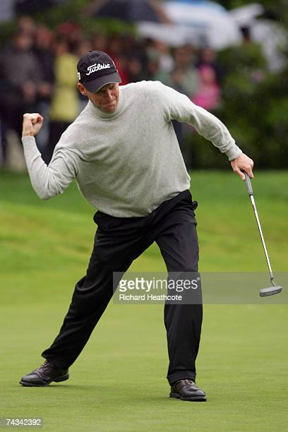 Anders Hansen of Denmark celebrates holing the winning putt during a play off on the 18th green during the Final Round of the BMW PGA Championship at...