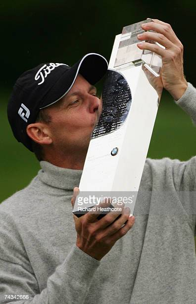 Anders Hansen of Denmark kisses the trophy following his victory in a play off at the end of the Final Round of the BMW PGA Championship at The...