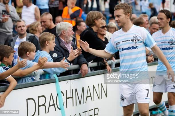 Anders Holst of FC Helsingor and Frederik Bay of FC Helsingor celebrate with fans after the Danish Alka Superliga match between FC Helsingor and...