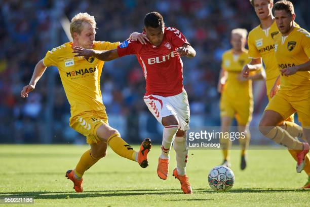 Anders Holvad of FC Fredericia and Allan Sousa of Vejle Boldklub compete for the ball during the Danish NordicBet Liga match between Vejle Boldklub...