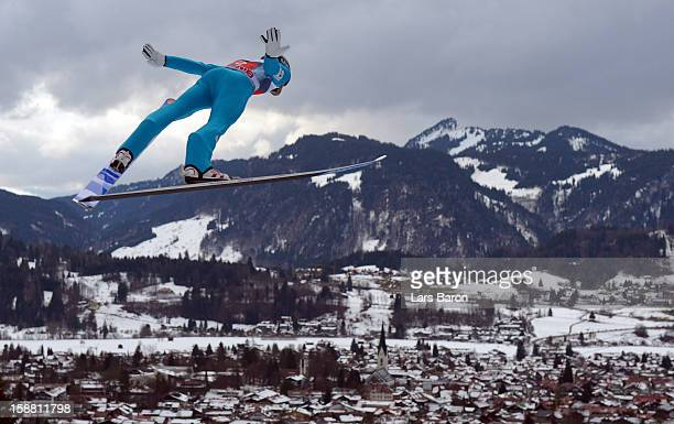 Anders Jacobsen of Norway competes during the trail round for the FIS Ski Jumping World Cup event at the 61st Four Hills ski jumping tournament at...