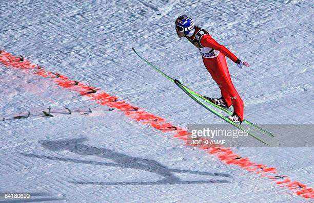 Anders Jacobsen of Norway prepares to land to set the longest 1375 meter jump during the qualification at the final fourth stage of the Four Hills...