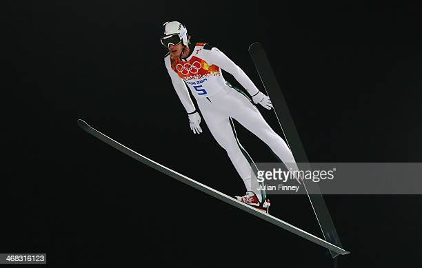 Anders Johnson of the United States jumps during the Men's Normal Hill Individual on day 2 of the Sochi 2014 Winter Olympics at the RusSki Gorki Ski...