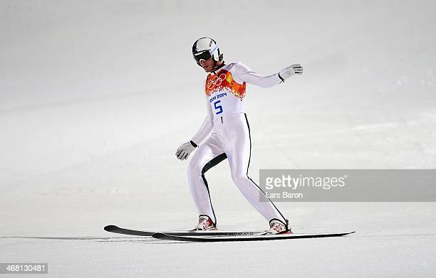 Anders Johnson of the United States lands his jump in the Men's Normal Hill Individual Final on day 2 of the Sochi 2014 Winter Olympics at the RusSki...