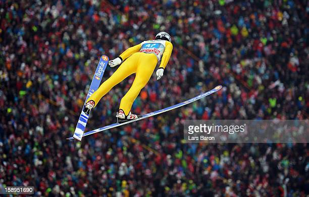 Anders Johnson of USA competes during the first round for the FIS Ski Jumping World Cup event of the 61st Four Hills ski jumping tournament at...