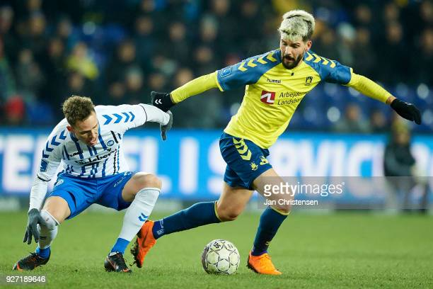 Anders K Jacobsen of OB Odense and Anthony Jung of Brondby IF compete for the ball during the Danish Alka Superliga match between Brondby IF and OB...