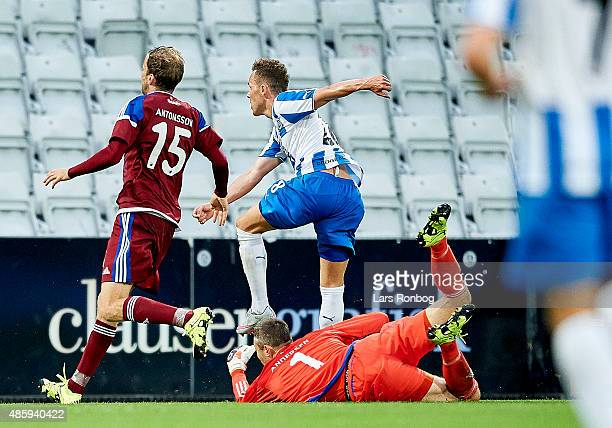 Anders K Jacobsen of OB Odense scores the 10 goal against Goalkeeper Stephan Andersen of FC Copenhagen during the Danish Alka Superliga match between...