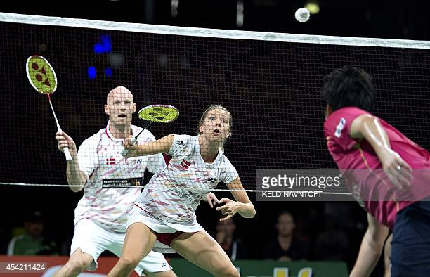 Anders Kristiansen and Julie Houmann from Demark play against Kenichi Hayakawa and Misaki Matsutomo of Japan during their match at the 2014 BWF...
