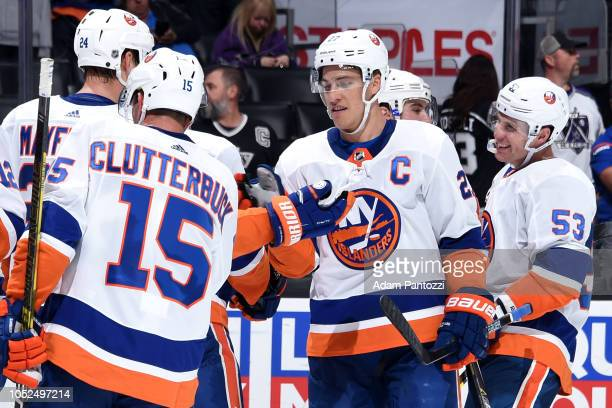 Anders Lee and Casey Cizikas of the New York Islanders celebrate after defeating the Los Angeles Kings 72 in the game at STAPLES Center on October 18...