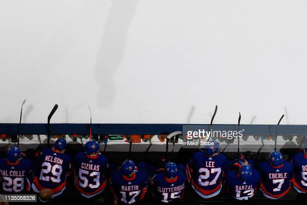 Anders Lee and Mathew Barzal of the New York Islanders in action againt the Buffalo Sabres at NYCB Live's Nassau Coliseum on March 30 2019 in...