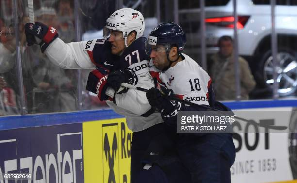 Anders Lee and Slovakia´s Andrej Kudrna vie during the IIHF Ice Hockey World Championships first round match between Slovakia and USA in Cologne,...
