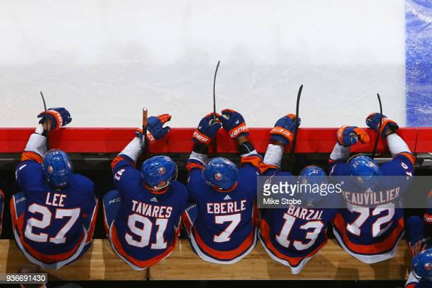 Anders Lee John Tavares Jordan Eberle Mathew Barzal and Anthony Beauvillier of the New York Islanders sit on the bench during the first period...