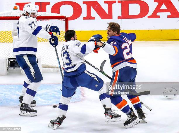Anders Lee of the New York Islanders and Cedric Paquette of the Tampa Bay Lightning exchange punches during the second period in Game Three of the...