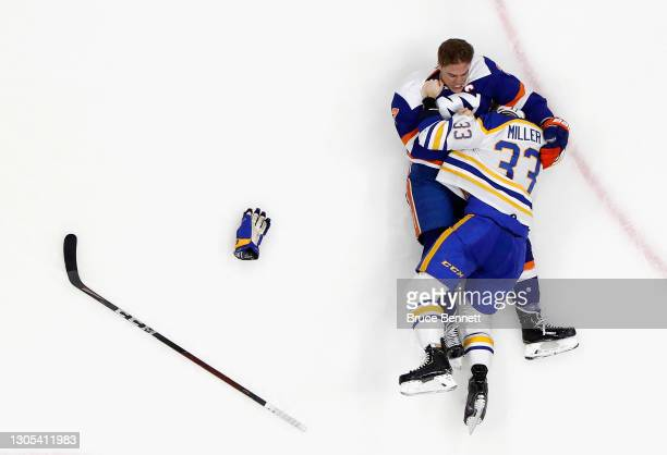 Anders Lee of the New York Islanders and Colin Miller of the Buffalo Sabres get penalties for roughing during the third period at the Nassau Coliseum...