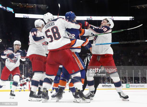 Anders Lee of the New York Islanders and Pierre-Luc Dubois of the Columbus Blue Jackets exchange pushes during the third period at NYCB Live's Nassau...
