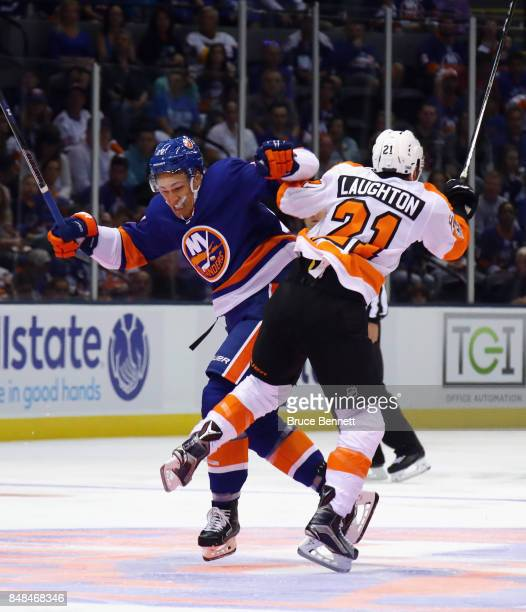 Anders Lee of the New York Islanders and Scott Laughton of the Philadelphia Flyers collide during the first period during a preseason game at the...