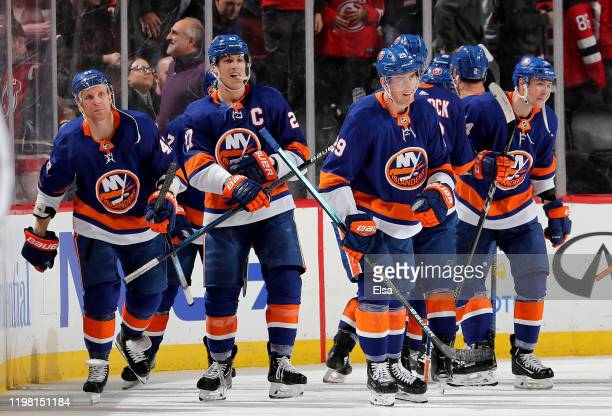Anders Lee of the New York Islanders and the rest of his teammates celebrate the overtime win over the New Jersey Devils at Prudential Center on...