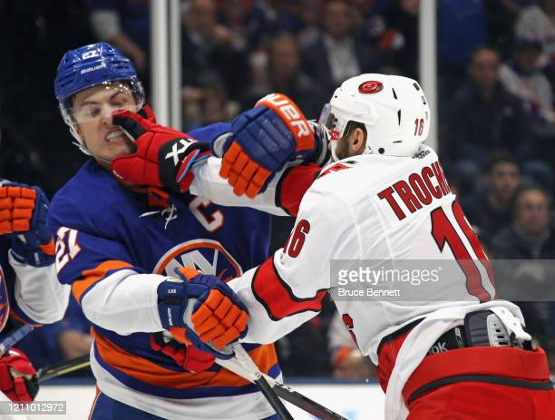 Anders Lee of the New York Islanders and Vincent Trocheck of the Carolina Hurricanes battle during the first period at NYCB Live's Nassau Coliseum on...