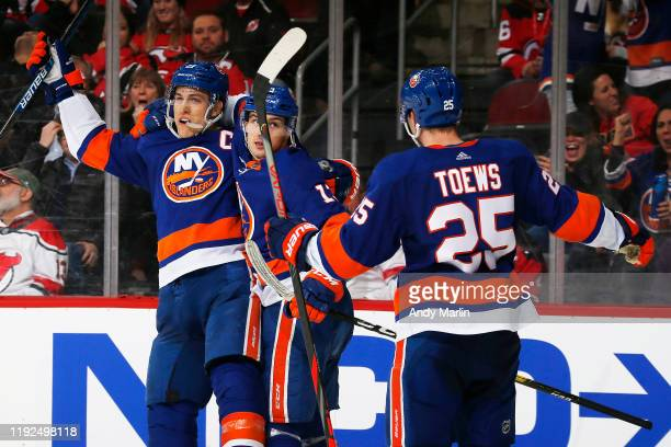 Anders Lee of the New York Islanders celebrates his game winning goal in overtime during the game against the New Jersey Devils at the Prudential...