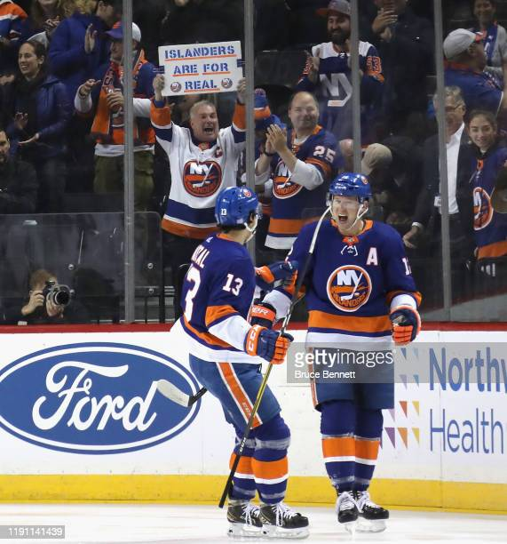 Anders Lee of the New York Islanders celebrates his goal at 1:18 of the first period against the Columbus Blue Jackets and is joined by Mathew Barzal...