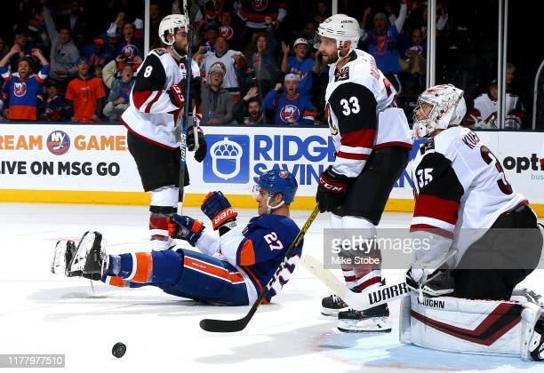 Anders Lee of the New York Islanders celebrates his goal past Darcy Kuemper of the Arizona Coyotes during the third period at NYCB Live's Nassau...