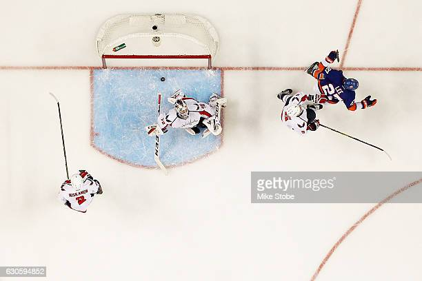 Anders Lee of the New York Islanders celebrates his third period goal as Braden Holtby of the Washington Capitals looks on at the Barclays Center on...