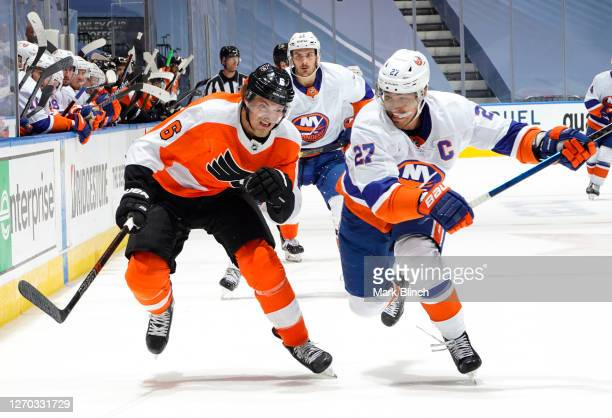 Anders Lee of the New York Islanders chases Travis Sanheim of the Philadelphia Flyers during the second period of Game Five of the Eastern Conference...