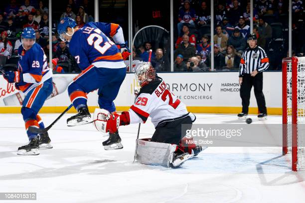 Anders Lee of the New York Islanders deflects a shot for a first period goal past Mackenzie Blackwood of the New Jersey Devils at Nassau Veterans...