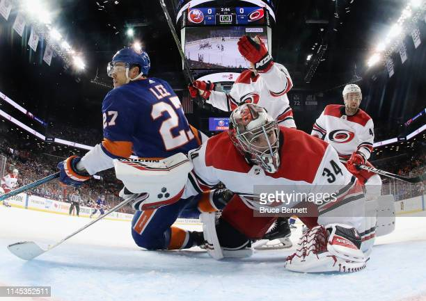 Anders Lee of the New York Islanders is called for goaltender interference during the second period against Petr Mrazek of the Carolina Hurricanes in...