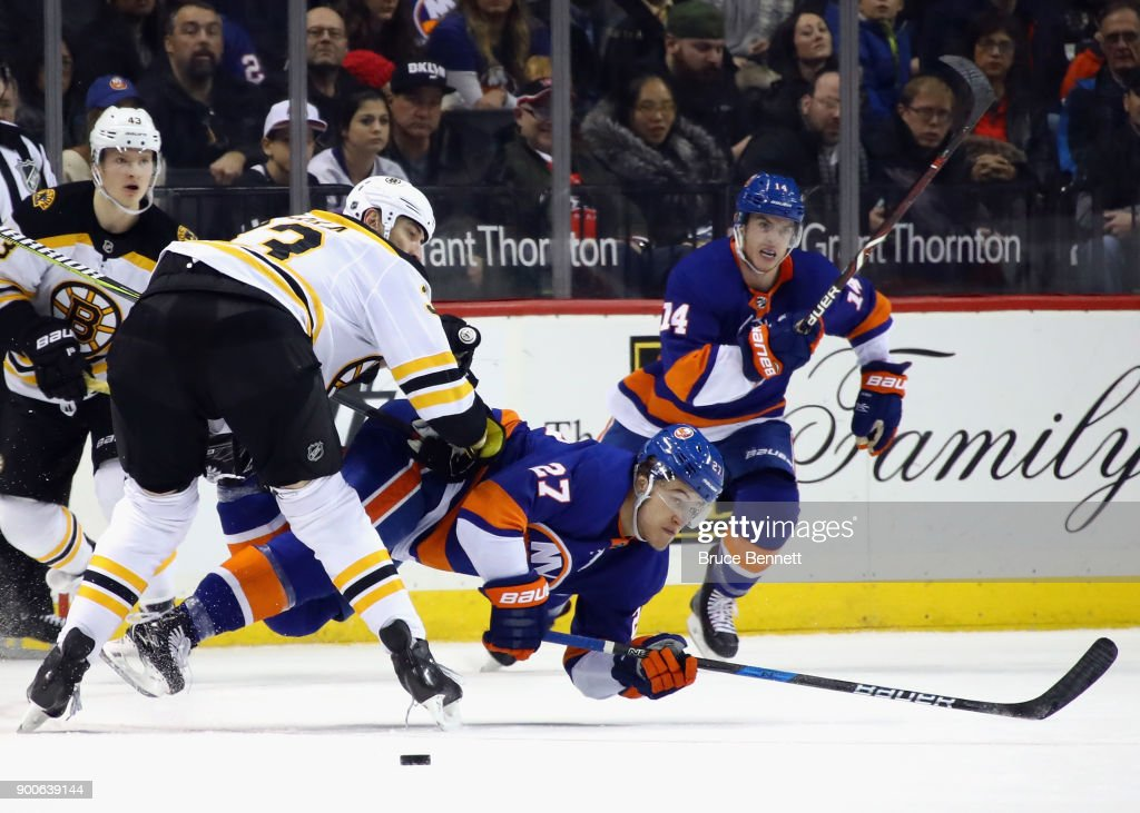 Anders Lee #27 of the New York Islanders is checked by Zdeno Chara #33 of the Boston Bruins during the second period at the Barclays Center on January 2, 2018 in the Brooklyn borough of New York City.