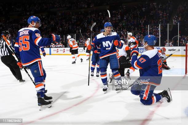 Anders Lee of the New York Islanders is congratulated by his teammates after scoring a goal against the Philadelphia Flyers during the first period...