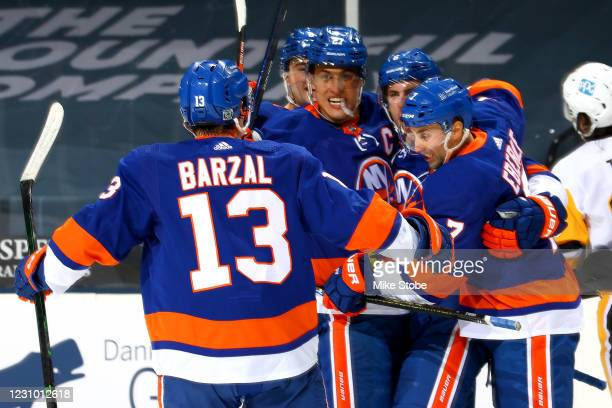 Anders Lee of the New York Islanders is congratulated by his teammates after scoring a goal against the Pittsburgh Penguins during the third period...
