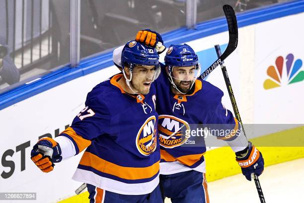 Anders Lee of the New York Islanders is congratulated by his teammate Jordan Eberle after scoring a goal at 1450 against the Washington Capitals...