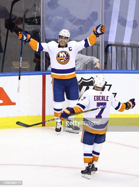 Anders Lee of the New York Islanders is congratulated by his teammate Jordan Eberle after scoring a goal against the Philadelphia Flyers during the...